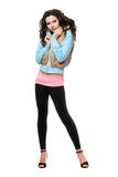 Beautiful young brunette in a black leggings. Isolated Royalty Free Stock Photography