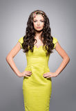 Beautiful, young brunette in bright dress wearing golden coronet Royalty Free Stock Image