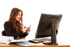 Beautiful young brunette business woman surt internet on her tab Royalty Free Stock Image