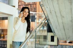 Brunette businesswoman talking on phone royalty free stock photography