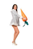 Beautiful young brunette with a carrot Stock Photo