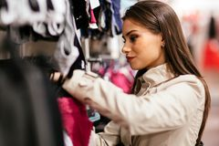 Beautiful brunette buying clothes Stock Image