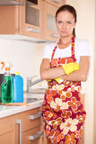 Beautiful young brunette cleaning kitchen. Royalty Free Stock Image