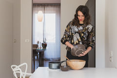 Beautiful young brunette cooking in the kitchen Stock Image