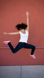 Beautiful young brunette dancer girl leaping Stock Images
