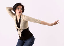Beautiful young brunette dancing. To the tunes isolated on a white background stock photos