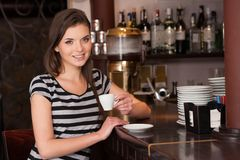 Beautiful young brunette drinking coffee. stock images