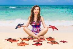 Beautiful young brunette enjoying the sun on the tropical coast Stock Photo