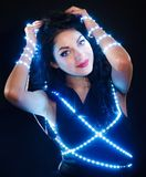 Beautiful young brunette with fairy lights Stock Photo