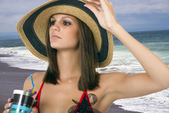 Beautiful young brunette female at the beach Stock Photos