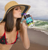 Beautiful young brunette female at the beach Stock Images