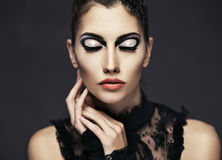Beautiful young brunette female with fashion make-up royalty free stock photo