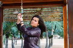 Beautiful young    brunette fixing outdoor decoration on tropical beach Royalty Free Stock Photography