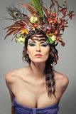Beautiful young brunette with flowers in hair. Stock Photos