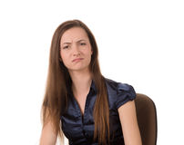 Beautiful young brunette frowning. Portrait of beautiful young woman frowning and looking upset, white background Stock Images