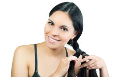 Beautiful young brunette girl braiding hair Stock Images