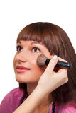 Beautiful young brunette girl doing makeup Royalty Free Stock Photography