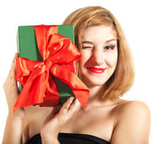 Beautiful young brunette girl holding present Stock Image