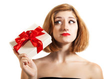 Beautiful young brunette girl holding present Stock Photography