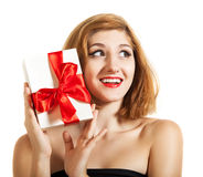 Beautiful young brunette girl holding present Royalty Free Stock Image