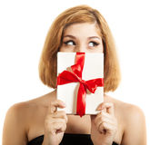 Beautiful young brunette girl holding present Stock Photo