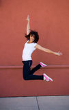 Beautiful young brunette girl jumping for joy Stock Images