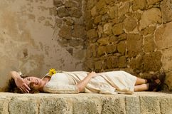 Beautiful young brunette girl lie down on wall Royalty Free Stock Image