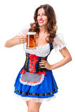 Beautiful young brunette girl of oktoberfest beer stein. Beautiful young brunette girl in dirndl drinks out of oktoberfest beer stein. Isolated on white Stock Image