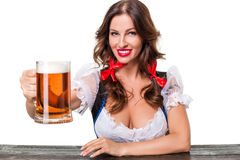 Beautiful young brunette girl of oktoberfest beer stein. Beautiful young brunette girl in dirndl drinks out of oktoberfest beer stein. Isolated on white Royalty Free Stock Images