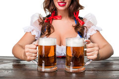 Beautiful young brunette girl of oktoberfest beer stein. Beautiful young brunette girl in dirndl drinks out of oktoberfest beer stein. Isolated on white Royalty Free Stock Photo
