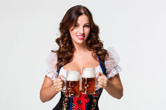 Beautiful young brunette girl of oktoberfest beer stein Stock Photos