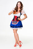 Beautiful young brunette girl of oktoberfest beer stein. Beautiful young brunette girl in dirndl drinks out of oktoberfest beer stein. on white background. full Royalty Free Stock Images