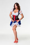 Beautiful young brunette girl of oktoberfest stein stock photos