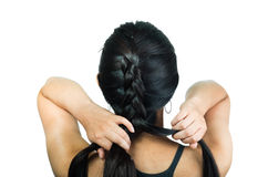 Beautiful young brunette girl plaiting her black Stock Image