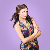 Beautiful young brunette girl in purple dress Stock Photo