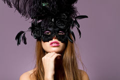 Beautiful young brunette girl wearing mask Stock Photo