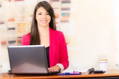 Beautiful young brunette girl working with laptop Stock Photography