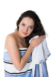 Beautiful young brunette girl wrapped in towel Stock Photo