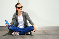 Beautiful young brunette hair hipster woman listening music earp Royalty Free Stock Image