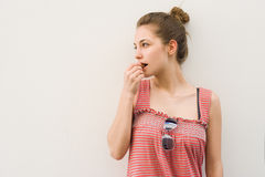 Beautiful young brunette having chocolate snack. Stock Photography
