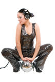 Beautiful young brunette in headphones Stock Photos