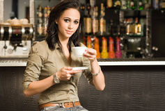 Beautiful young brunette and her coffee. Royalty Free Stock Image