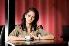 Beautiful young brunette and her coffee. Stock Images