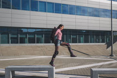 Beautiful young brunette jumping in the city streets Stock Photo