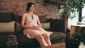 Lonely Caucasian woman in dress waiting her date in a cafe stock video footage