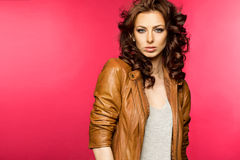 Beautiful young brunette in the leather jacket Stock Photo