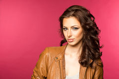 Beautiful young brunette in the leather jacket Stock Images