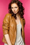 Beautiful young brunette in the leather jacket Stock Image