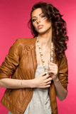 Beautiful young brunette in the leather jacket Royalty Free Stock Images