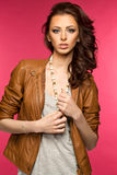 Beautiful young brunette in the leather jacket Royalty Free Stock Photo
